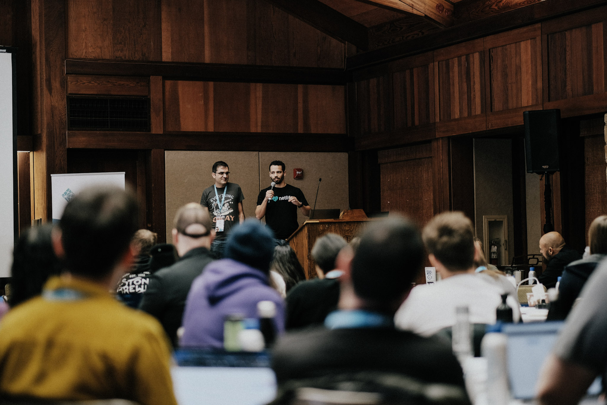 two engineers from the Netlify CMS team presenting from the stage