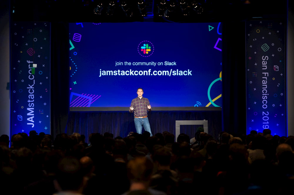 The JAMstack_conf stage with a link to the community slack